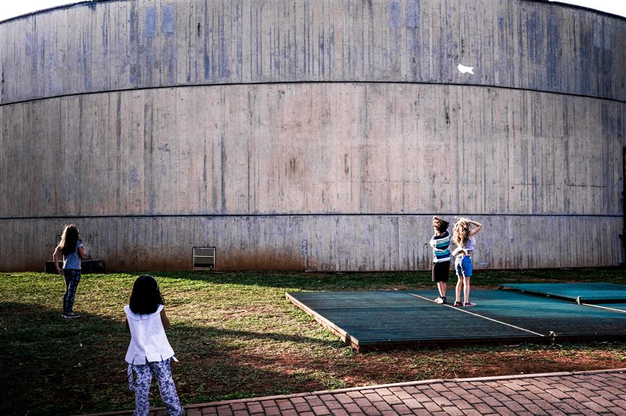 Discover Original Art by Ricardo Perini | Kids playing at Brasilia Museum photography | Art for Sale Online at UGallery
